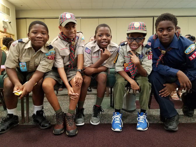 Cub Scouts in the front row, ready to become Boy Scouts